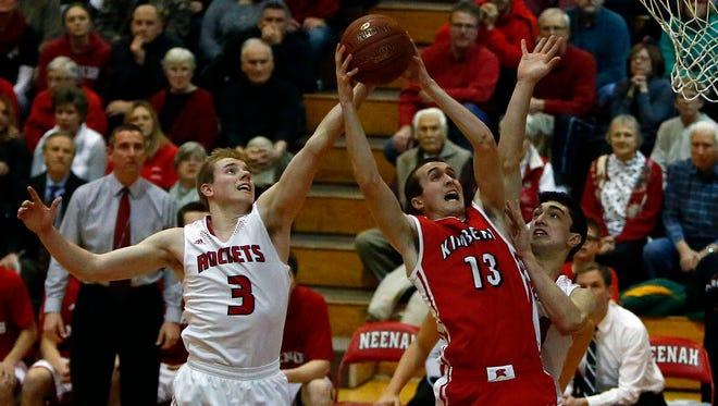 Caleb Lefeber of Kimberly  (right) battles Neenah's Ty Hegg during a Fox Valley Association boys' basketball matchup Dec. 12 at Neenah High School.