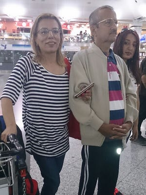 Amal Saleh and her husband, Abdulhamit Saleh, wait at the airport in Istanbul, Turkey, for their flight to the U.S. in July 2015. The Syrian couple fled their home in Aleppo as the peak of the country's civil war but are now living in South Florida after winning refugee status for themselves and their four children.