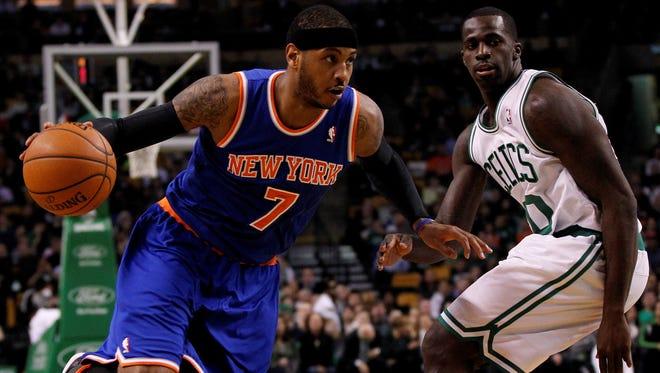 Knicks forward Carmelo Anthony drives past Boston's Brandon Bass on Wednesday night.