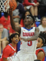 Cooper's Matthew Falade drives to the basket against