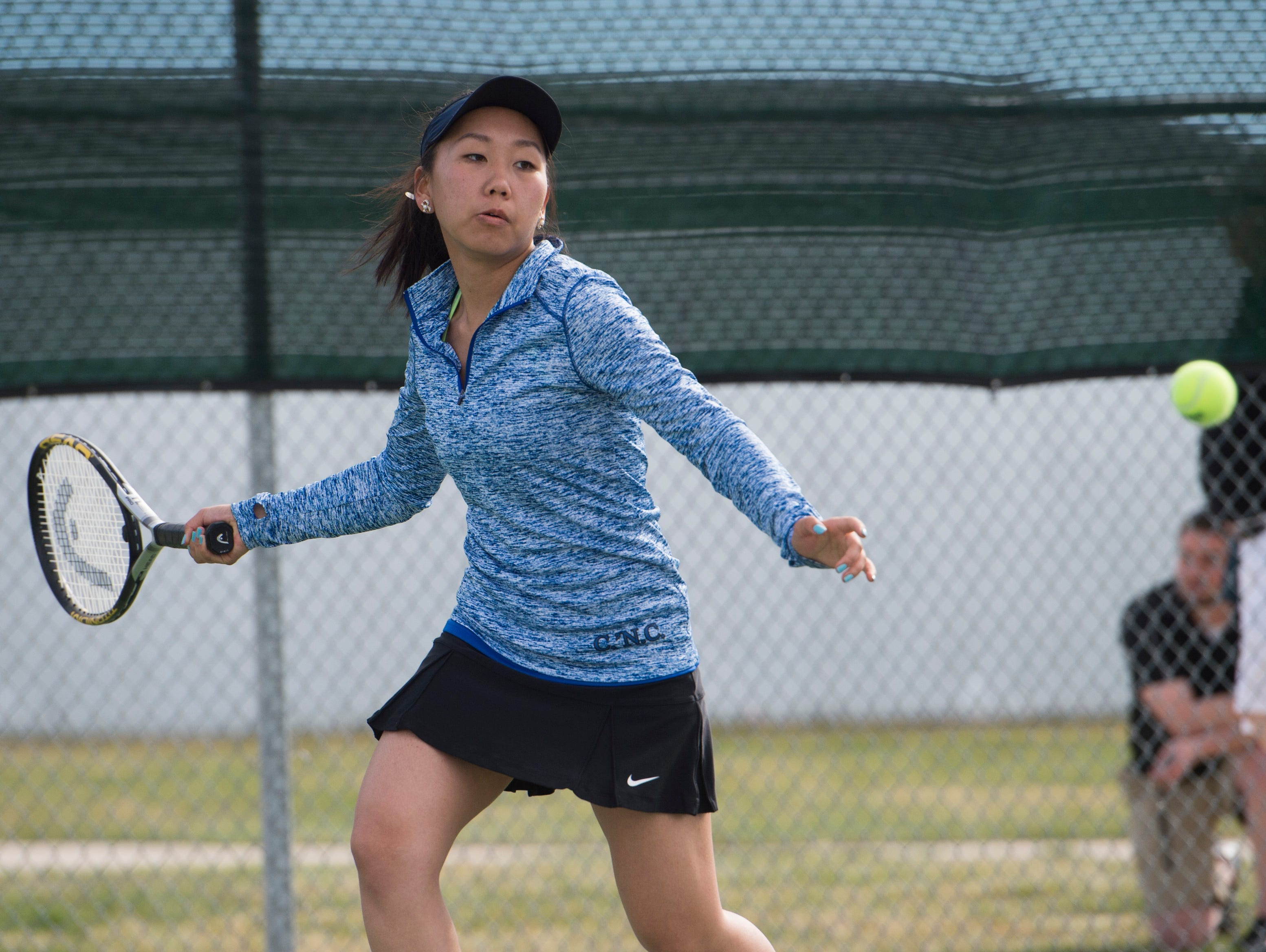 Mimi Mijiddorj of Poudre returns the ball to a Fossil Ridge High School doubles team during a match Wednesday, April 6, 2016.