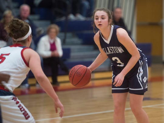 Dallastown's Julia Sutton dribbles the ball against New Oxford's Presley Berryhill during play on Friday, Dec. 23, 2016. Dallastown fell to New Oxford 48-44.