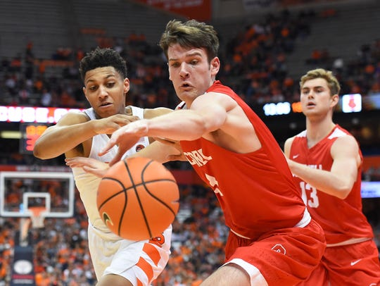 Cornell forward Jimmy Boeheim reaches for a loose ball