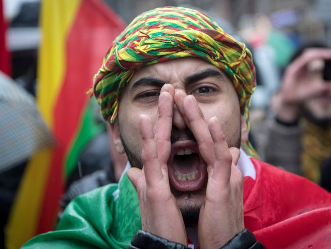 A member of the Kurdish community in Germany shouts