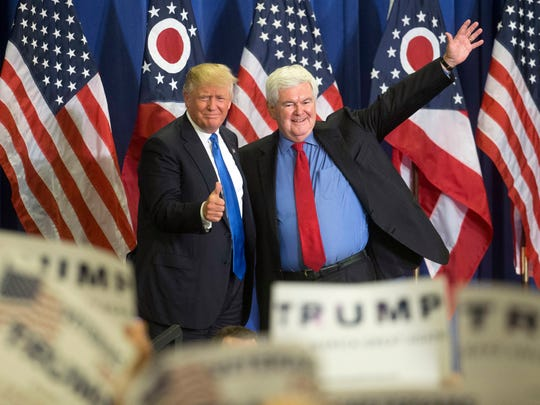 Donald Trump and Newt Gingrich acknowledge the crowd