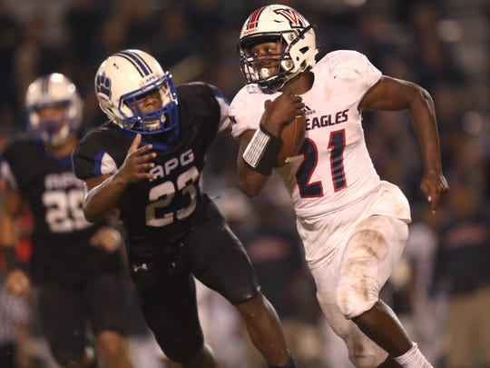 Godby's Tarian Lee Jr. chases down Wakulla's Lamonta Peterson during their game at Cox Stadium on Friday.