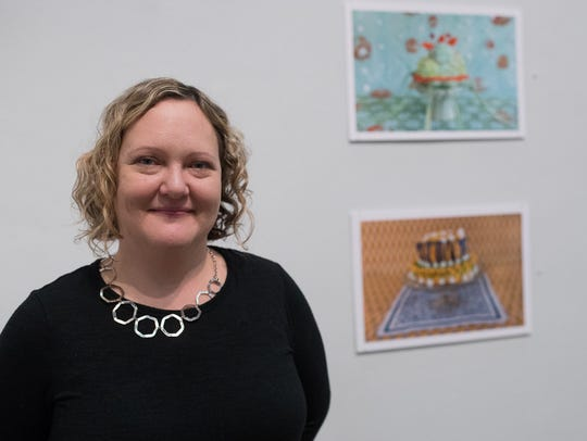 Amy Stevens poses with her photographs Jan. 26, 2018. Her photo series titled, Confections will be on display at the Weil Gallery at Texas A&M University-Corpus Christi from Jan. 26 through March 6, 2018.