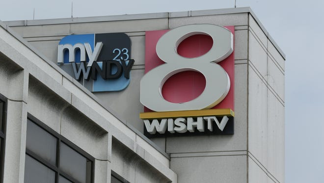 The WISH-8 and WNDY-23 logos are shown mounted on the station in Downtown Indianapolis on Aug. 11, 2014.