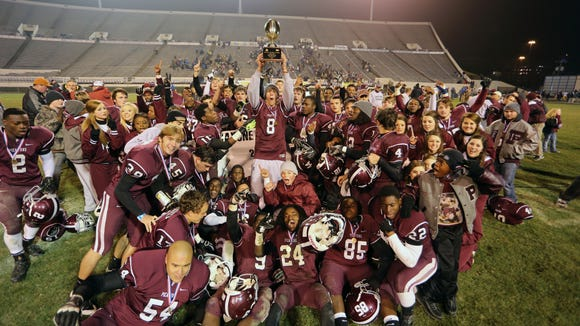 Picayune High School players celebrate with the MHSAA Class 5A Football Championship trophy after coming from behind to defeat Oxford. (Photo by Keith Warren)