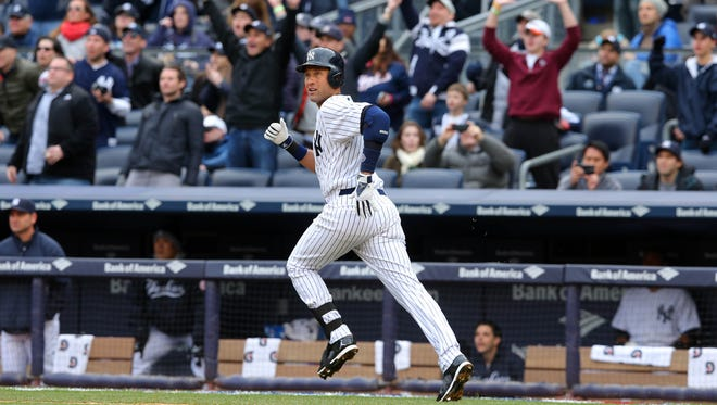 Yankees shortstop Derek Jeter watches the flight of the ball as he runs up the first-base line in the fifth inning Monday against Baltimore. Jeter had to hustle to leg out a double, and the Yankees went on to win 4-2.