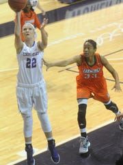 Abilene Christian's Sierra Allen (22) drives for a shot as Texas-Rio Grande Valley's Mary Savoy defends. ACU beat the Vaqueros 70-54 in a Preseason WNIT consolation game Saturday, Nov. 19, 2016 at Moody Coliseum.