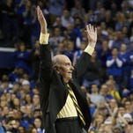 Herky Rupp, son of Adolph Rupp, waves to the crowd during a timeout in the second half of play against Florida at Rupp Arena in Lexington, Ky. March 7, 2015.
