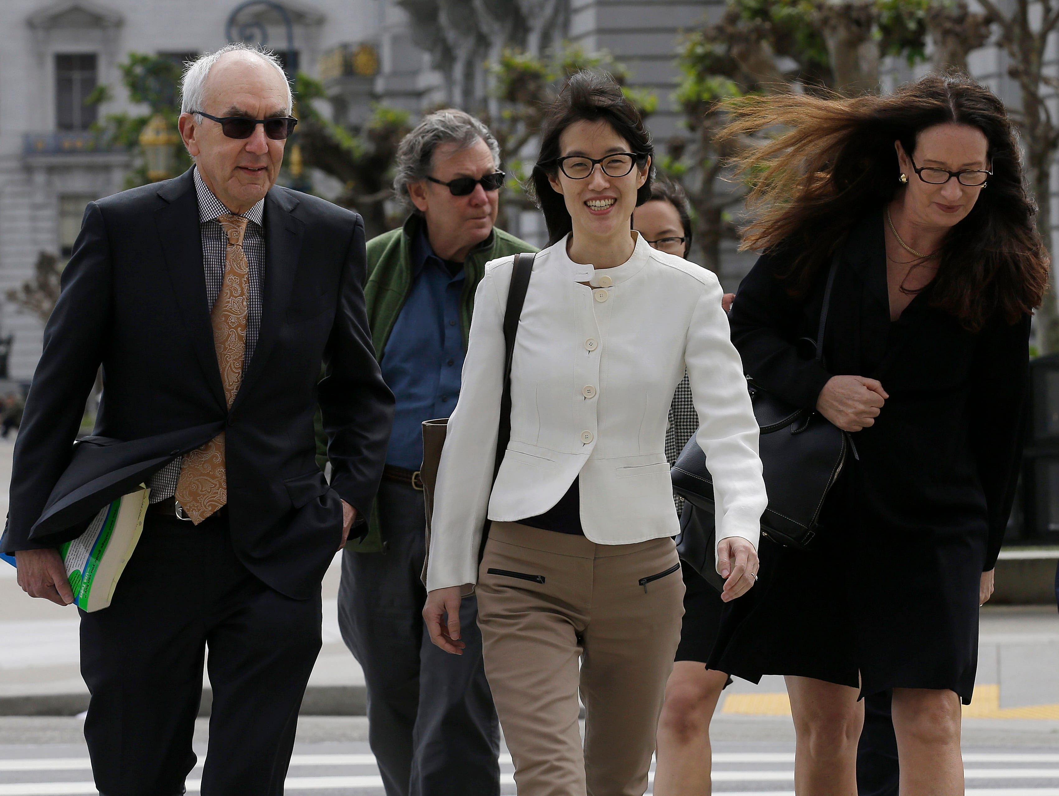 Ellen Pao, center, walks to Civic Center Courthouse in San Francisco March 27. A jury ruled against Ellen Pao in her sex discrimination case against venture capital firm Kleiner Perkins Caufield & Byers.