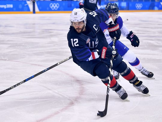 USA forward and captain Brian Gionta of Greece in action. Aquinas product had great scoring chance vs. Slovakia late Monday.