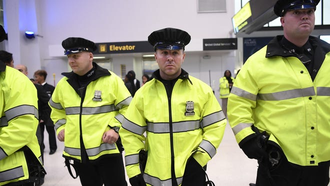 Security was heightened at Terminals B and C for the rally, but the protesters and those passing by stayed peaceful at Newark Liberty International Airport on Tuesday.
