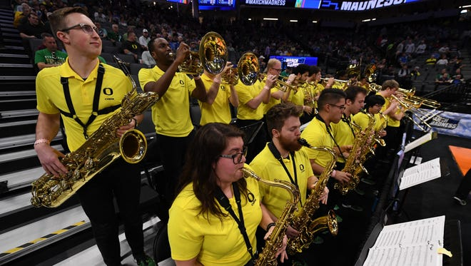 Mar 17, 2017; Sacramento, CA, USA; Members of the Oregon Ducks band perform prior to the first round of the 2017 NCAA Tournament between the Oregon Ducks and the Iona Gaels at Golden 1 Center. Mandatory Credit: Kyle Terada-USA TODAY Sports