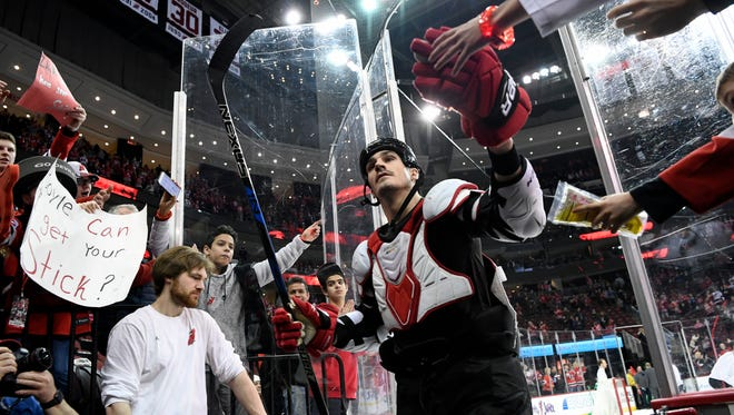 New Jersey Devils center Brian Boyle high-fives fans as he walks off the ice. The New Jersey Devils defeated the Toronto Maple Leafs 2-1 at the Prudential Center in Newark, NJ on Thursday, April 5, 2018.