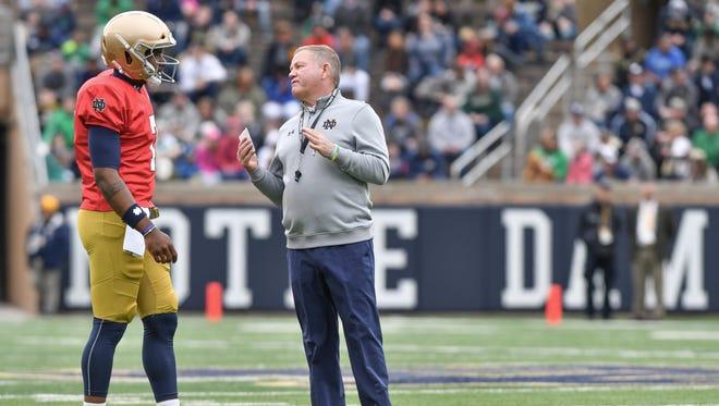 Apr 21, 2018; Notre Dame, IN, USA; Notre Dame Fighting Irish head coach Brian Kelly talks to quarterback Brandon Wimbush (7) in the first quarter of the Blue-Gold Game at Notre Dame Stadium. Mandatory Credit: Matt Cashore-USA TODAY Sports