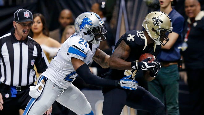New Orleans Saints wide receiver Brandin Cooks (10) pulls in a touchdown reception from Drew Brees as Detroit Lions cornerback Nevin Lawson (24) covers Dec. 21, 2015.