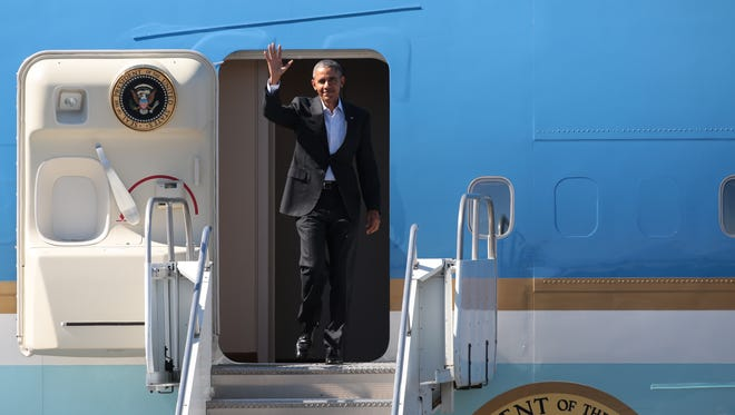 President Obama waves as he descends Air Force One after arriving in Palm Springs on Feb. 12, 2016.