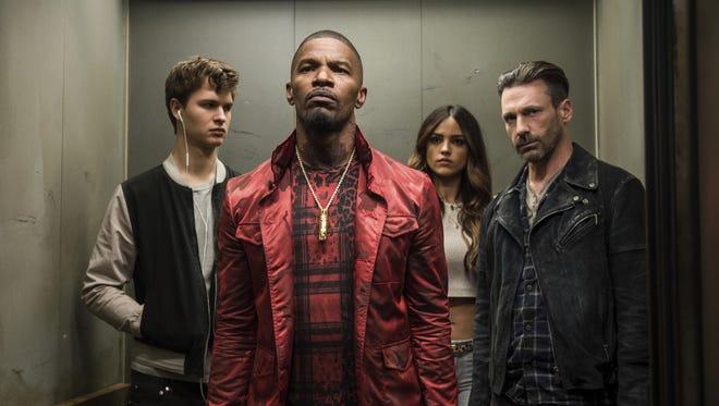 "Ansel Elgort, Jamie Foxx, Eiza Gonzalez and Jon Hamm in a scene from ""Baby Driver."""