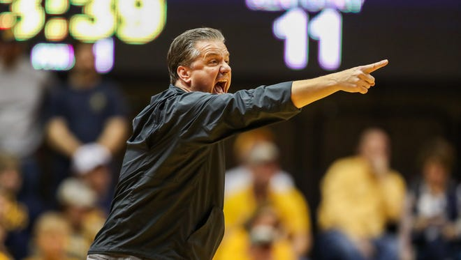 Kentucky Wildcats head coach John Calipari calls out a play from the bench during the first half against the West Virginia Mountaineers at WVU Coliseum in Morgantown, West Virginia, on Saturday, Jan. 27, 2018.