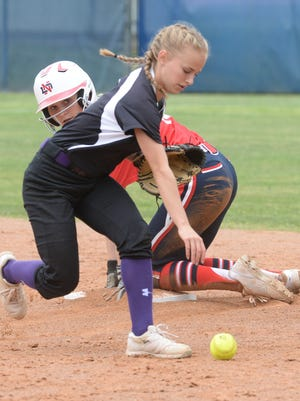 Emma Callie Delafield watches as Trinity Axtell chases the ball at second.