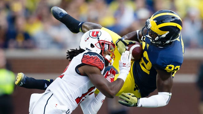 Michigan wide receiver Amara Darboh takes a hit from Utah defensive back Justin Thomas. The Utes won 26-10, and Michigan's fortunes look dicey.