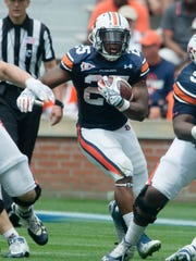Auburn running back Peyton Barber runs downfield during the Auburn A-Day spring game on Saturday, April 18, 2015, at Jordan-Hare Stadium in Auburn, Ala.