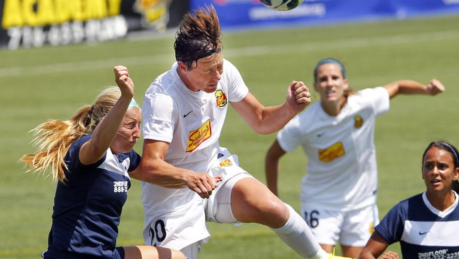 Abby Wambach, center, returns for her second season with the Western New York Flash.