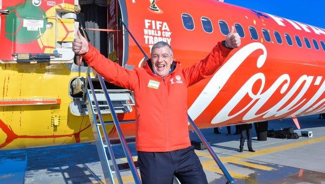 President of Coca-Cola Ltd., Nicola Kettlitz attends the Canadian soccer fans getting up close and personal with the FIFA World Cup trophy in Toronto in February.