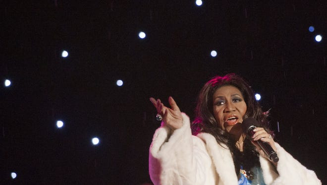 Singer Aretha Franklin performs during the National Christmas Tree Lighting ceremony on the Ellipse adjacent to the White House in Washington, D.C., Dec. 6, 2013.