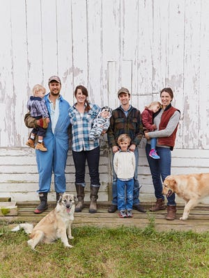 The Uplands Cheese family includes (from left) Scott and Liana Mericka and their sons, Everett and Henry; Andy and Caitlin Hatch with their son, Augie, and daughter, Gillie; and dogs Clover and Marshall.