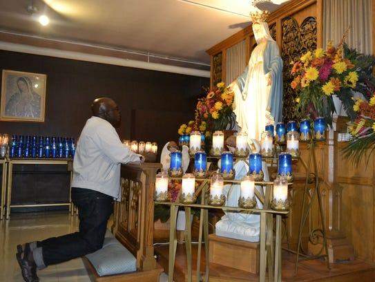 -GPG Rwandan priest at Shrine of Our Lady of Good Help photo 2.jpg_20140918.jpg
