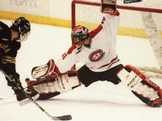 St. Cloud State goaltender Brian Leitza kicks away