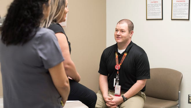 Justin Wright, M.D., (right) advises many of his diabetic patients to lose weight; losing weight can often help control the disease. Photo by Tommie Morelos/TTUHSC El Paso