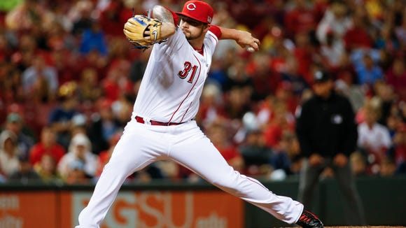 Reds relief pitcher Brandon Finnegan throws in the sixth inning of a baseball game against the St. Louis Cardinals, Friday, Sept. 11, 2015, in Cincinnati.