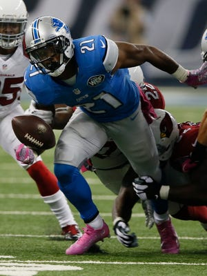 Detroit Lions running back Ameer Abdullah fumbles the ball for a turnover against the Arizona Cardinals on October 11, 2015, in Detroit.