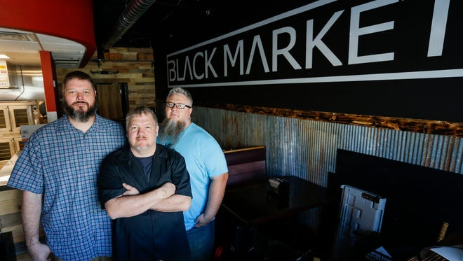 From left, Jason Delcour, Wesley Johnson and Scott Pitts are opening Black Market Smokehouse which is located at 603 S. Kimbrough Ave.