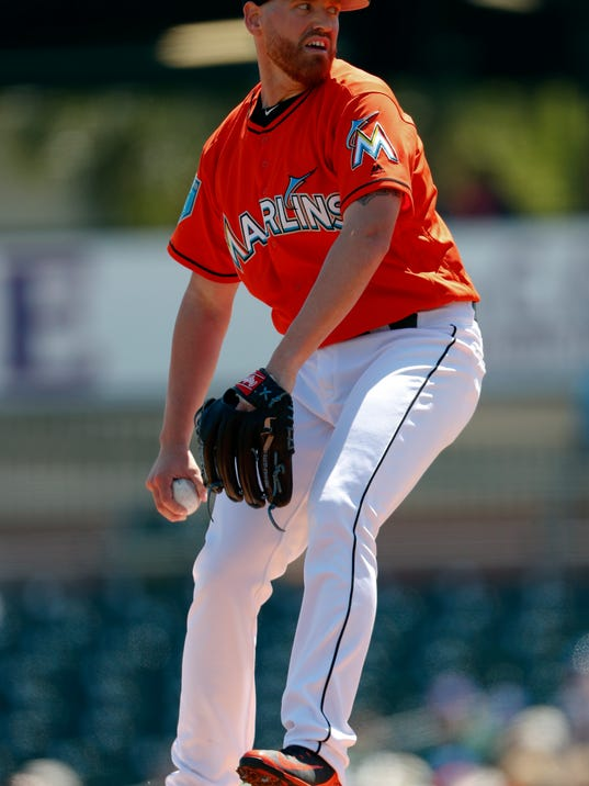 Miami Marlins starting pitcher Dan Straily (58) works against the New York Mets in the first inning of a spring training baseball game Wednesday, March 14, 2018, in Jupiter, Fla. (AP Photo/John Bazemore)