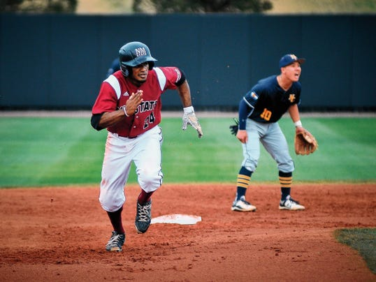 Jett Loe/Sun-News   New Mexico State University outfielder Quinnton Mack runs towards third base in Friday's game against Northern Colorado at Presley Askew Field.