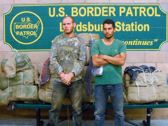 From left are Mexican Nationals, Julio Herrera Lopez, 23, and Hector Leyva Garcia, 32, along with bundles of illegal drugs.