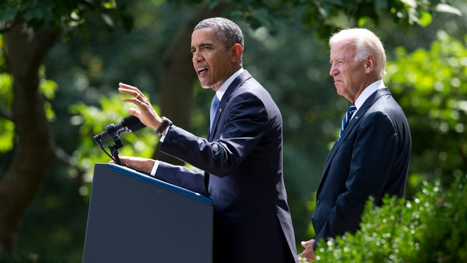 President Obama, flanked by Vice President Joe Biden, makes a statement about the crisis in Syria in the Rose Garden at the White House in Washington on Saturday, Aug. 31, 2013.