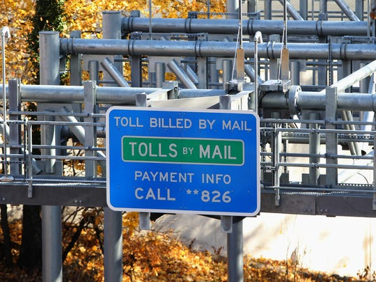 A tolls by mail sign on the New York State Thruway electronic toll gantry on the exit 10 entrance ramp in South Nyack Dec. 1, 2017.