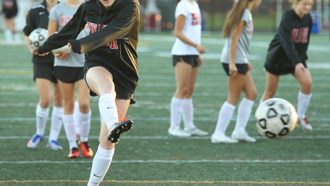 Hingham star scorer Eve Hewins shoots for the net as Hingham girls soccer practices for the state championship game, Friday, Nov. 18, 2016.