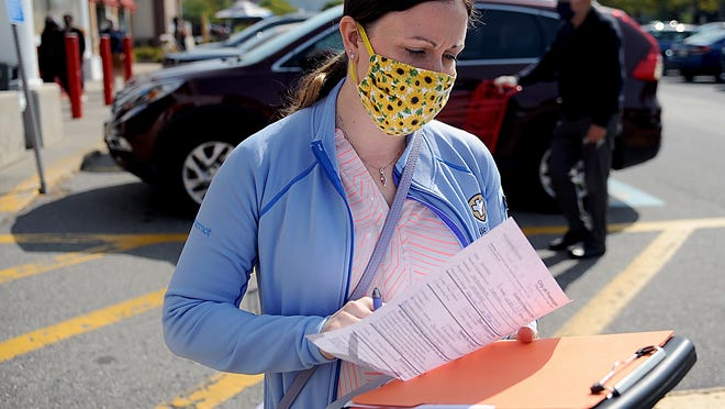 Framingham Public Health Dept. Inspector Camile Griffin is seen outside a COVID-19 related inspection on Sept. 24.