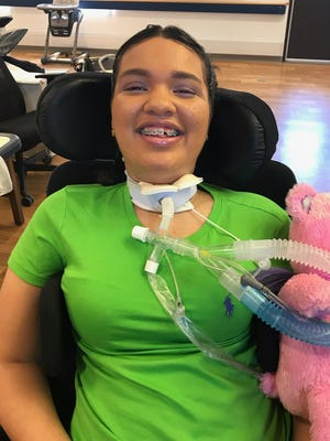 Sky Mendoza smiles in a wheelchair in a rehabilitation facility in Albany. Mendoza is a stage four paraplegic after she was injured in a November 2018 car accident that killed her stepmother.