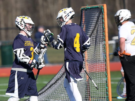 From left, Highland's Roger Hegeman (3) celebrates his first period goal with teammate Danny Rusk (4) during boys lacrosse action at Franklin D. Roosevelt High School in Staatsburgh  March 18, 2017.