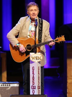 Bill Anderson performs Aug. 8, 2015, at the Grand Ole Opry with his Grammer guitar that had been missing for nearly 50 years.