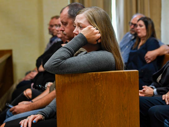 Lisa Baker sits with friends and other family members